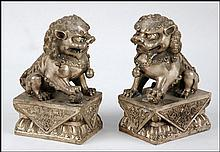 PAIR OF CHINESE METAL FOO DOGS.