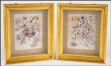 A SET OF TWO CONTINENTAL STYLE PAINTED PORCELAIN FLORAL STILL LIFES.