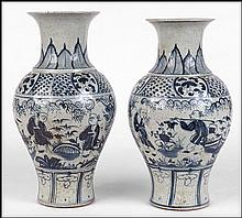 PAIR OF CHINESE BLUE AND WHITE PORCELAIN VASES.
