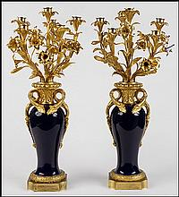 PAIR OF FRENCH GILT BRONZE AND PORCELAIN CANDELABRUM.