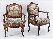 PAIR OF FRENCH CARVED WALNUT NEEDLEPOINT UPHOLSTERED OPEN ARMCHAIRS.