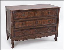 A 17TH CENTURY ITALIAN WALNUT THREE- DRAWER COMMODE.