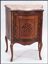 AN ITALIAN MARBLE TOP CABINET.