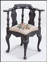 TUDOR STYLE CARVED MAHOGANY CORNER CHAIR.