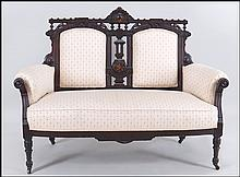CONTINENTAL UPHOLSTERED MAHOGANY SETTEE.