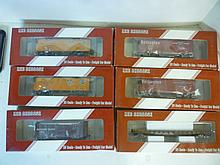 MODEL TRAIN CARS: (2) BOX CARS, (2) REFRIGERATOR MODEL TRAIN CARS: (2) BOX CARS, (2) REFRIGERATOR. CARS, (1) FLAT CAR, AND (1) STOCK CAR. ALL DIFFERENT CAR NUMBERS, ALL BY RED CABOOSE