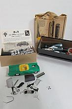 3 CAR AND SPACESHIP MODELS (NO BOXES) 3 IN 1 1932 FORD COUPE MODEL W/ INSTRUCTIONS , UNKOWN CONVERTIBLE CAR PARTIALLY PAINTED AND PUT TOGETHER, VINTAGE 1958 REVELL  SPACESHIP WITH LAUNCHING PAD
