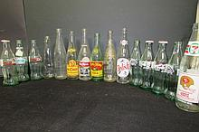 15 ASSORTED VINTAGE SODA BOTTLES 8 COCA COLA, ROYAL CROWN, RED ROCK, BIG CHIEF, PLUS OTHERS