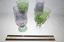 4 ART GLASS WINE GLASSES TWO 6 1/2 INCH GREEN AND CLEAR GLASS TWO 7 INCH PURPLE WITH GREEN GLASS