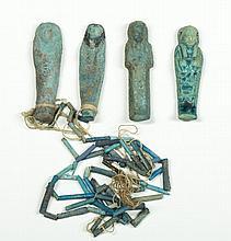 Four Egyptian Blue Faience Ornaments