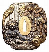 A BRASS KAKU-MOKKOGATA (SHINCHU) TSUBA, 20TH