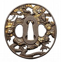AN OVAL IRON TSUBA, 19TH CENTURY pierced and