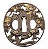 AN OVAL IRON TSUBA, 19TH CENTURY pierced and