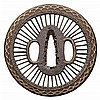 A CIRCULAR IRON ONIN STYLE TSUBA, 19TH CENTURY the