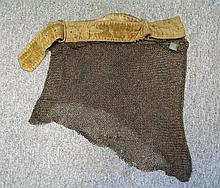 A SKIRT OF MAIL, 19TH CENTURY BUT PROBABLY CUT FROM AN EARLIER MAIL SHIRT OF EASTERN ORIGIN