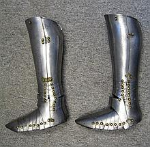 A PAIR OF SOUTH GERMAN GREAVES AND SABATONS, LATE 16TH CENTURY
