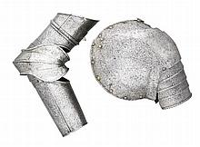 A  COMPOSITE NORTH ITALIAN PAULDRON AND VAMBRACE FOR THE RIGHT ARM, WITH ETCHED DECORATION, PROBABLY MILANESE, CIRCA 1590
