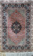 A CHINESE TURKISH HEREKE PATTERN SILK RUG