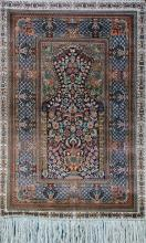 A CHINESE TURKISH HEREKE PATTERN SLIK RUG