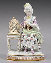 A MEISSEN PORCELAIN FIGURE EMBLEMATIC OF TOUCH FROM THE FIVE SENSES