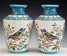 A PAIR OF PORCELAIN AND ENAMEL VASES