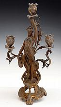 A EUROPEAN BRONZE 3 LIGHT CANDLESTICK MODELED IN THE FORM OF A NEOCLASSICAL LADY