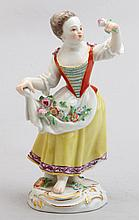 A MEISSEN PORCELAIN FIGURE OF A CHILD GARDENER HOLDING A FLOWER