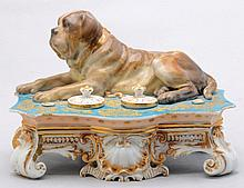 A FRENCH PORCELAIN INKSTAND MODELED WITH A DOG