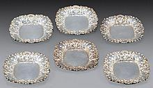A SET OF SIX MINIATURE SILVERPLATED PLATES