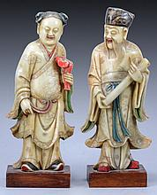 A PAIR OF CHINESE SOAPSTONE FIGURES IN THE FORM OF A SCHOLAR AND A WOMAN