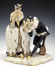 A ROYAL DUX PORCELAIN GROUP FIGURE OF A MAN AND A WOMAN