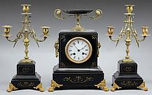 A FRENCH NAPOLEON III CLOCK WITH TWO CANDELABRAS