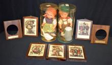 Assorted Goebel Hummel Collectibles: 1.) Plastic Boy Doll with stein and turnips in original box; 2.) Plastic Girl Doll with geese in original box; 3.) 5 decoupage wooden wall plaques with Hummel scenes; 4.) 2 wooden frames with metal tags.  Tallest 11 1/2