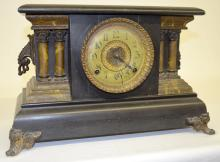 Antique Ingraham Black Mantel Clock: T&S with a signed Ingraham paper chapter ring dial with a patterned metal center and an unsigned movement. The pendulum is with the clock. Not tested. 10 3/4