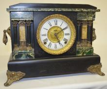 Antique Ingraham 6 Column Mantel Clock: T&S w/ signed paper chapter ring dial, patterned metal center,   unsigned movement, black enamel case w/faux green marble accents, 2 styles of columns & metal ornaments. Paper label on the back.