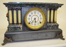 Antique Seth Thomas 6 Column Mantel Clock: T&S w/signed Seth Thomas paper dial & signed movement. In a black enamel case w/faux green marble accents, celluloid Ivory columns & metal ornaments. Not tested. 11 1/4