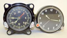 Two Vintage Russian Airplane Gauges: 1.) W/2 ring dial - 60 second and 24 hour, 55M - 1880 and in a metal case. 2.) W/1 ring dial - 12 hour, in a metal case. There are Russian words on the knobs. Largest 3 1/2