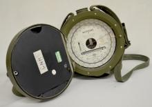Vintage Wallace & Tiernan Military U.S. Surveying Altimeter, portable with a carrying strap and a metal case marked U.S. 8 1/2