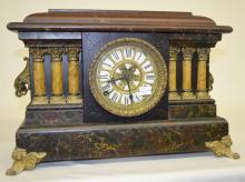 Antique 6 Column Mantel Clock: T&S with an unsigned paper dial with ornate metal overlay; an unsigned movement; the pendulum and key. The case is faux marble with 6 celluloid ivory columns. Not tested. 11 3/4