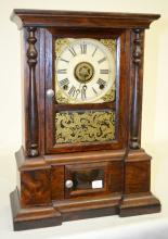 Antique Atkins Rosewood Shelf Clock: T&S with alarm; an unsigned paper dial; a stenciled door with a hunter and a lion scene on it and a good interior label. The pendulum is with the clock. Not tested. 16 3/4