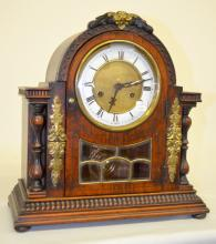 Antique German Hamburg American Shelf Clock: T&S with a signed Germany porcelain chapter ring dial with a plain center. The case has leaded glass and metal ornamentation. The pendulum and key are with the clock. 14
