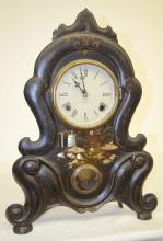 Antique Iron Front Mantel Clock, Chauncey Jerome: with a T&S movement; painted metal dial; M.O.P. inlay on the clock case. It has a jewelers label inside and on the back. The paint looks original and is in good shape. Not tested. 20 1/4