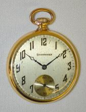 South Bend Studebaker 21J 16S OF PS 8 Adjustments DMK DR Pocket Watch No. 1105832: With a metal dial and in a yellow, S.W.C. Co. 14K gold filled, machined case No. 6439888. The watch is running at this time.