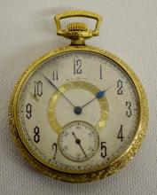 Elgin Model 2 15J 14S OF DMK 3/4 PS Pocket Watch No. 26671053: With a silvered dial in a yellow Illinois 20 Year Ramona SF&B case numbered 3795785.