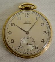 Banner 12S 17J OF GF Case Pocket Watch with a Monogrammed Dial with Seconds Bit. The watch is running at this time.