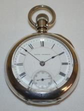 Seth Thomas 18S 7J OF Hinged Silver Case Pocket Watch with a Signed Porcelain Dial with seconds bit, Serial No. 34857; Safety Pinion; in a Newport Coin Case #633061 with floral engraving. The watch is running at this time.