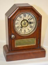Antique Seth Thomas Octagon Top Cottage Clock: T & S with alarm and a painted metal dial. The clock has the pendulum, a good interior label, winding arbors at the 3 & 7, and a mirrored lower door. Running. 9 1/2
