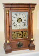 Antique Seth Thomas 1/4 Size Double Column Shelf Clock: T & S with alarm, a painted metal dial, the pendulum and key, a good interior label and a decorated lower glass door. The clock is running. 16