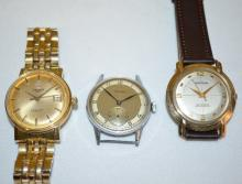 Three Men's Wrist Watches, Waltham, Arexo, Tissot Auto: 1.) Waltham Self Winding with a leather band. 2.) Arexo with a metal dial with seconds bit. 3.) Tissot Seastar Automatic with Day of the Month and a metal band.
