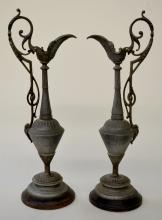 Antique Ansonia Clock Side Pitchers, Italian: Round metal bases with cast metal pitchers, finish appears original with a little wear, 16 5/8